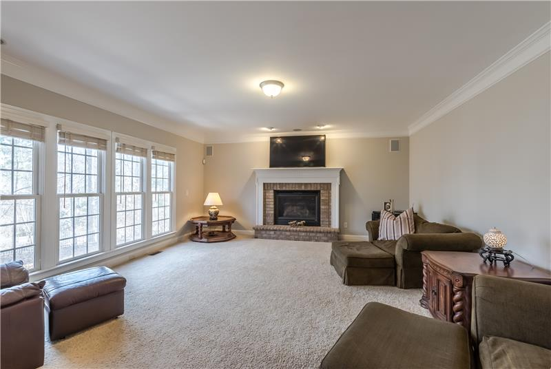 Large great room with a wall of windows  providing wonderful natural light.