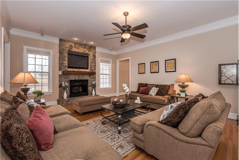 Features beautiful hardwood floors, crown molding throughout, built-in speakers.