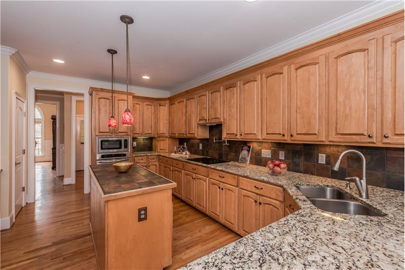 A kitchen made for the person who loves to cook and entertain with expansive granite counters, tons of cabinet storage.
