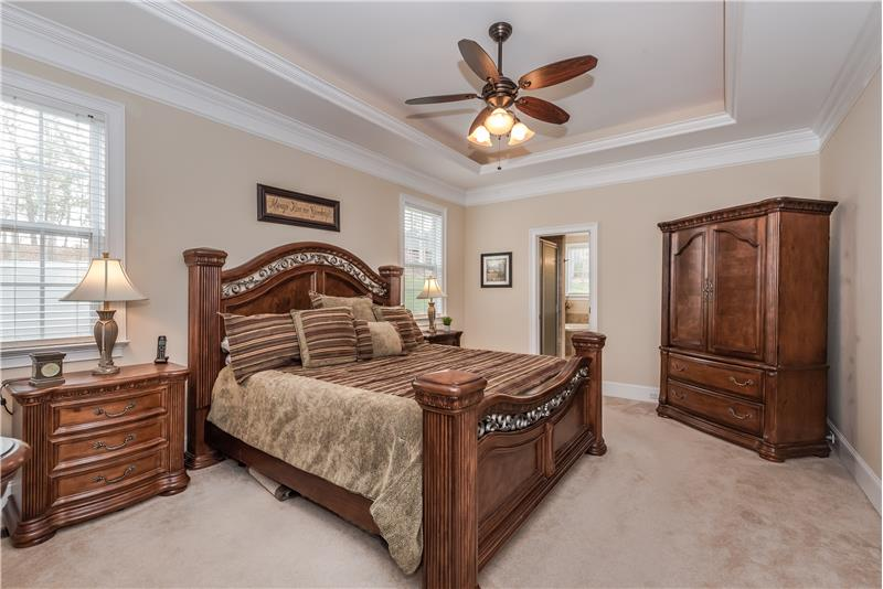Serene and spacious master suite on main floor of home. The home's split bedroom floor plan provides maximum privacy.