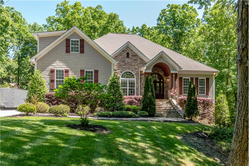 Welcome to 5092 Cambridge Oaks Drive, a custom-built home set on 1.52 acres in Weddington.
