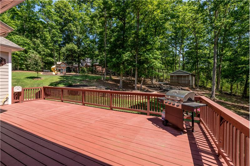 Huge deck is a natural extension of the home's living and entertaining space.