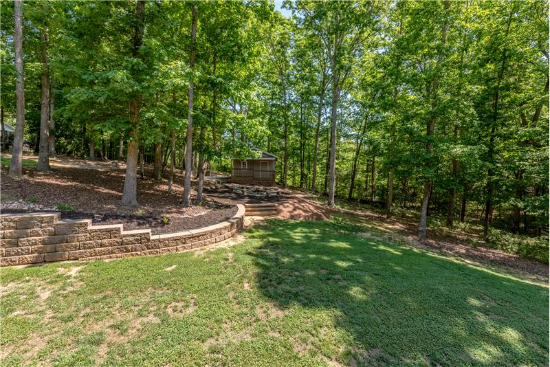Gorgeous wooded setting provides privacy and natural beauty year round.