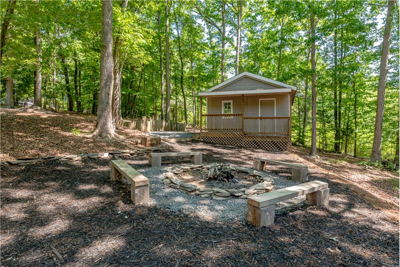 Fire pit with seating extends the home's outdoor living and entertaining spaces. 16' x 20' shed with area to store a boat.