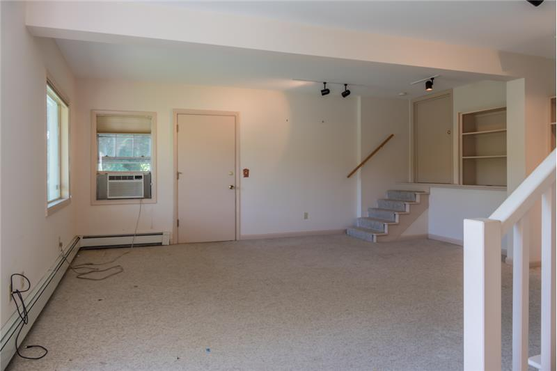Head down to the basement where you'll discover this flexible space perfect for office, playroom, or craft room.