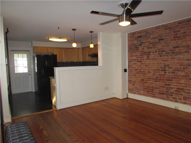 Rent 37 Thomas Avenue  Living Room with Exposed Brick Wall