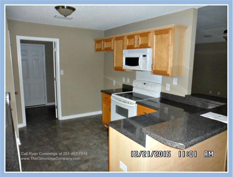 Kitchen with Breakfast Bar at 9661 Misty Leaf Dr, Mobile, AL 36695