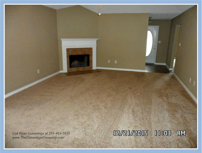Living Room with Fireplace at 9661 Misty Leaf Dr, Mobile, AL 36695